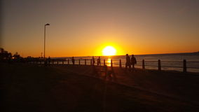 Sunset in Africa. Seapoint Promenade in Capetown Stock Photography