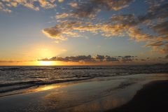 Sunset in the afternoon at the beach. This picture was Made yesterday afternoon. It was a cloudy bit also sunny day. The colors were so nice and beautiful at royalty free stock photography
