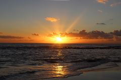 Sunset in the afternoon at the beach. This picture was Made yesterday afternoon. It was a cloudy bit also sunny day. The colors were so nice and beautiful at royalty free stock photo