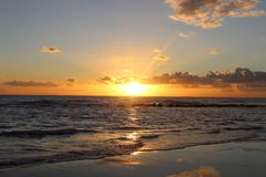 Sunset in the afternoon at the beach. This picture was Made yesterday afternoon. It was a cloudy bit also sunny day. The colors were so nice and beautiful at royalty free stock image
