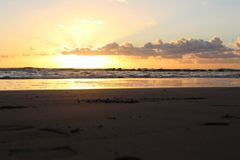 Sunset in the afternoon. This picture was Made yesterday afternoon. It was a cloudy bit also sunny day. The colors were so nice and beautiful at the beach. The royalty free stock images