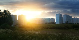 Sunset against the background of the block of flats, apartment buildings, in Europe in the field, new houses Royalty Free Stock Photos