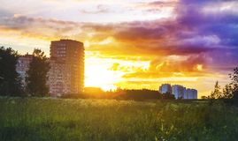 Sunset against the background of the block of flats, apartment buildings, in Europe in the field, new houses Stock Photography