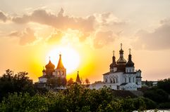 Sunset against Holy Trinity Monastery. Tyumen Stock Photo