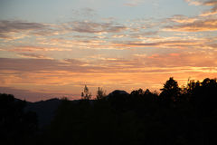 Sunset. Against a mountain with clouds stock photography