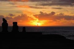 Sunset at Ahu Tahai. Long shot of the Moai during sunset at Ahu Tahai in Hanga Roa in Rapa Nui, Easter Island, Chile, South America Stock Photos