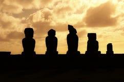 Sunset at Ahu Tahai. Long shot of the Moai during sunset at Ahu Tahai in Hanga Roa in Rapa Nui, Easter Island, Chile, South America Stock Photo