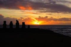Sunset at Ahu Tahai. Long shot of the Moai during sunset at Ahu Tahai in Hanga Roa in Rapa Nui, Easter Island, Chile, South America Stock Photography