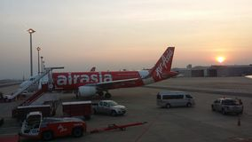 Sunset with Air Asia airplane scene Royalty Free Stock Photos