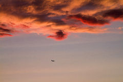Sunset and aircraft. Beautiful Sunset and an aircraft in the sky Stock Photo