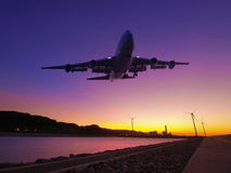Sunset and airplane Stock Photography