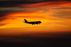 Sunset with airplane. Hong Kong, sunset on Airport seaside, airplane cross the sky stock photo
