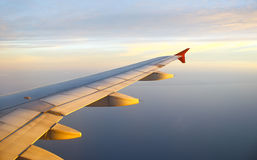 Sunset from airplane Stock Photo