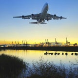Sunset and airplane Stock Images