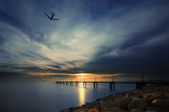 Sunset with airplane Stock Image
