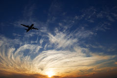 Sunset and airplane Royalty Free Stock Images