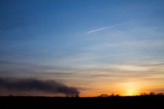 Sunset and airplane Royalty Free Stock Photo
