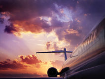 Sunset and airplane Stock Image