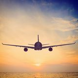 Sunset airplane Stock Photos