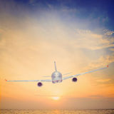 Sunset airplane Stock Photography