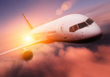 Sunset Airplane Travel. Airliner against the setting sun Royalty Free Stock Photography