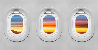 Sunset at airplane window. Background royalty free stock images