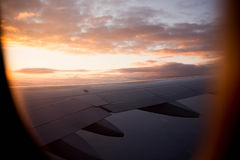Sunset from airplane window Stock Photography
