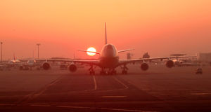 Sunset at the airport, airplane on the runway Stock Photography