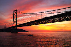 Sunset at Akashi Kaikyo Bridge Royalty Free Stock Photos