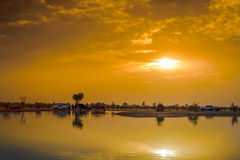 Sunset at Al Qudra Lake, Dubai. With sunbeams breaking out of the clouds royalty free stock image