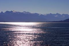 Sunset in Alaska. Sunset on the water in Alaska from a cruise ship Royalty Free Stock Image