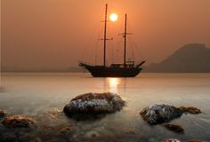 Sunset in Alicante Bay. Sailing boat anchored in Alicante Beach royalty free stock photo