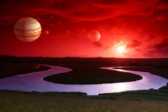 Sunset on alien world. A beautiful sunset reflecting off some gorgeous clouds and incorporated my planets for dramatic effect royalty free illustration