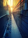 Sunset alley. Small alley way in the sunset Royalty Free Stock Photo