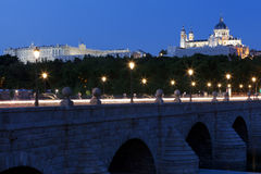 Sunset at the Almudena Church and Royal Palace seen from the Manzanares river Stock Images