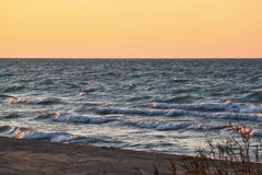 Sunset along beautiful Lake Michigan beach with view of Chicago skyline in far background royalty free stock photos
