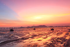 Sunset along the coast at magic hour Stock Images