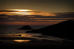 Sunset along coast at Porth Beach, Cornwall, England Stock Photography