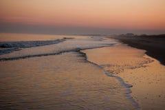 Sunset along Pawleys Island, S.C. A solitary figure walks along the beach a sunset. Pawleys Island, South Carolina Royalty Free Stock Images