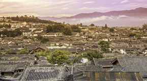 Sunset Along the Rooftops of Lijiang. Colors of sunset reflect off the ancient rooftops of the old town of Lijiang in northern Yunnan province in China Royalty Free Stock Photo