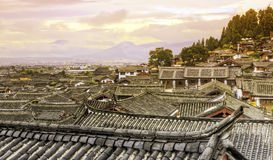 Sunset Along the Rooftops of Lijiang. Colors of sunset reflect off the ancient rooftops of the old town of Lijiang in northern Yunnan province in China Royalty Free Stock Photos