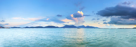 Sunset along sea stones coast in Hong Kong Royalty Free Stock Photography