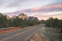 Sunset on highway with view of Sedona red rock formations in Arizona, USA Stock Image