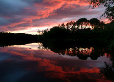 Sunset along a wild scenic river royalty free stock images