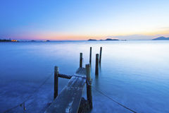 Sunset along a wooden pier Royalty Free Stock Photography