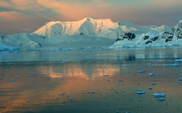 Sunset & alpenglow,. Mountains and mirror - calm ocean,Paradise harbor, Antarctica Royalty Free Stock Photo