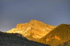 Sunset alpenglow on mountains Stock Image