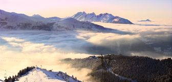 Sunset Alps in France. Winter sunny mountains peaks in Alps, France Royalty Free Stock Image