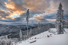 Sunset at Altitude in Cascade Mountains. Sunset Burns the Hills and Valleys in Snowy Scene from the Cascade Mountain Range Stock Photography