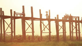 Sunset Amarapura U Bein Bridge Myanmar. People on famous U Bein Bridge at sunset in Amarapura, Myanmar stock footage